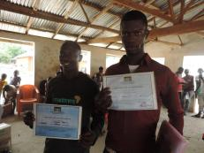 Visit to ebola survivor village Francis and Ibrahim with their survivors certificates which serve as prove that they are entitled to assistance